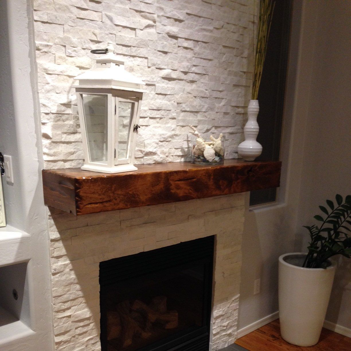 knotty alder beam mantel stained with minwax early american stain
