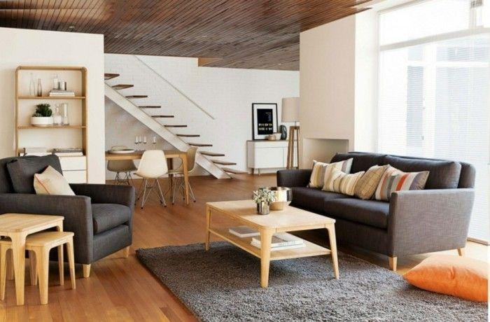 Wohnzimmer grau grauer teppich holztisch dekokissen dunkle