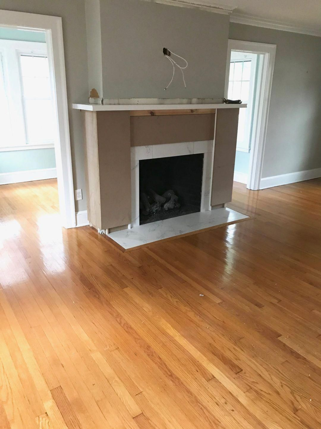 Fireplace makeover before and after covering the brick with wood