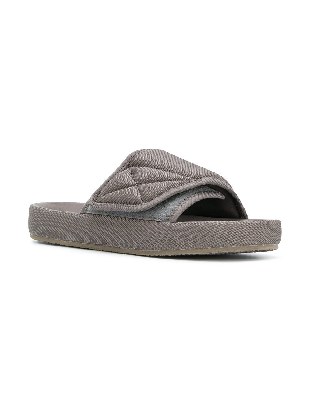 929cb7cf930c7  195.00 USD Graphite Slides   YEEZY Men s slides in taupe from YEEZY Season  6 constructed with