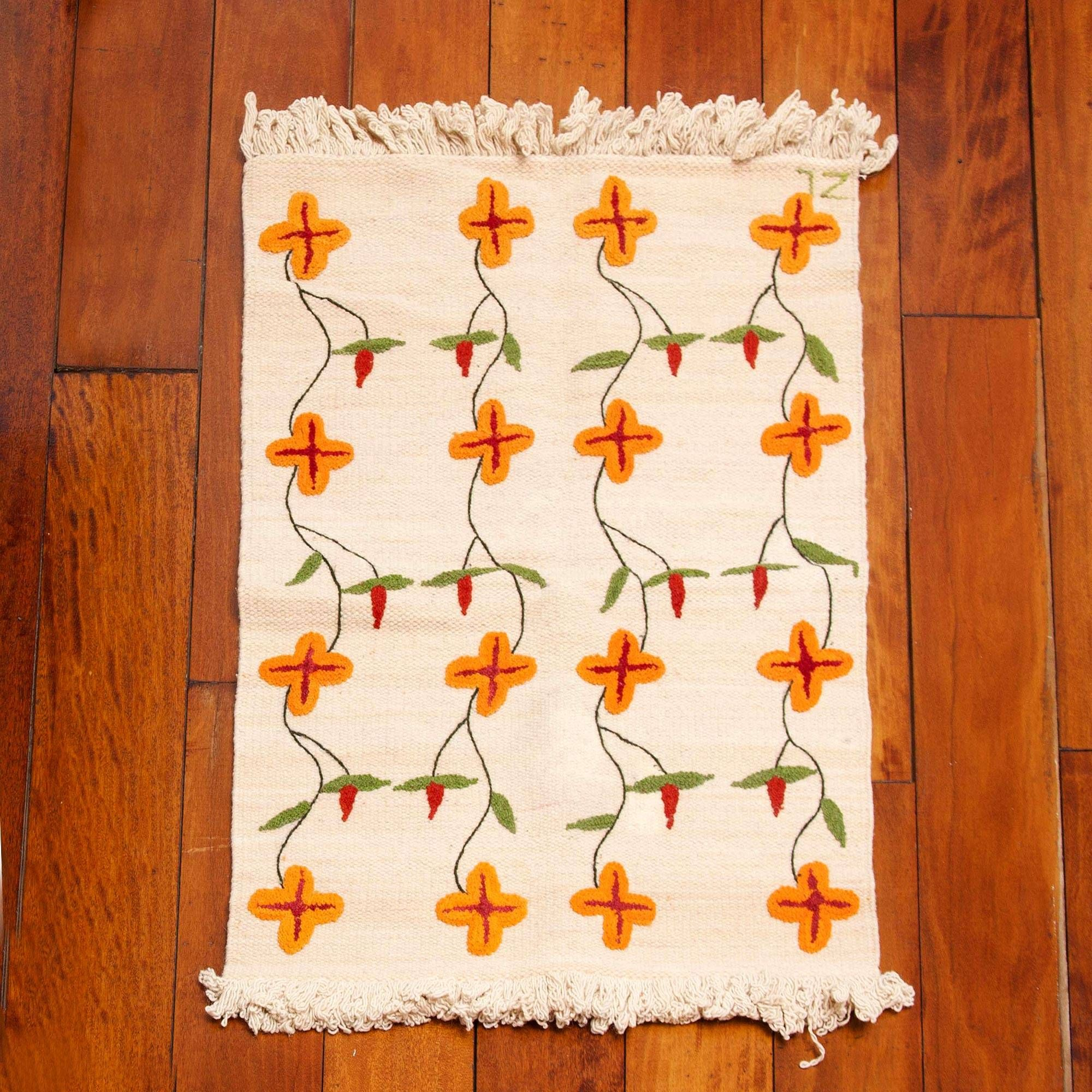 Hand woven floral peruvian wool x area rug in ecru floral