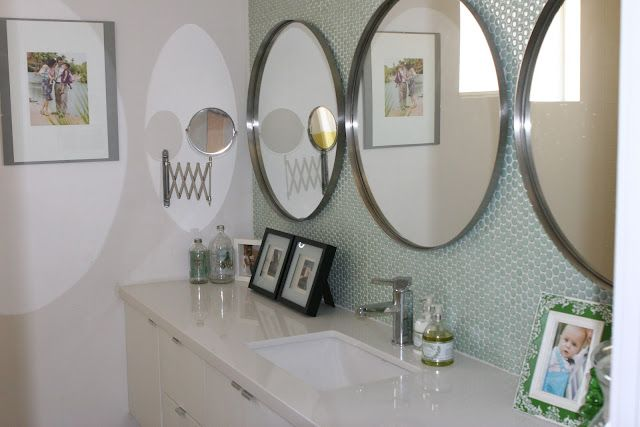 love the round mirrors to mix things up in the bathroom