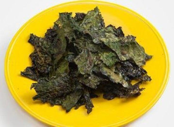 One nibble of these rosemary-infused kale chips will show you why kale chips are highly addictive and one of the trending organic foods for the new year.