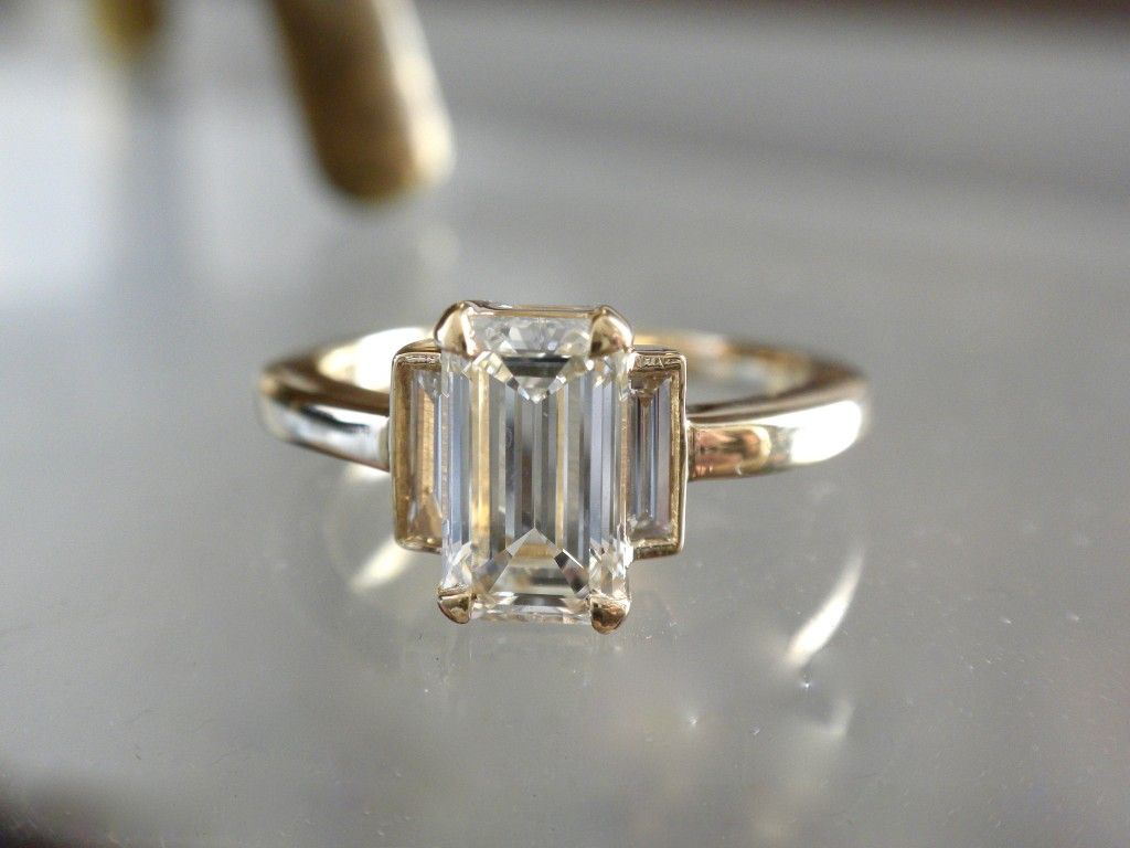 Elongated .92ct emerald cut accented by dramatic skinny special cut side stones in 14k yellow gold with open cuff ring.