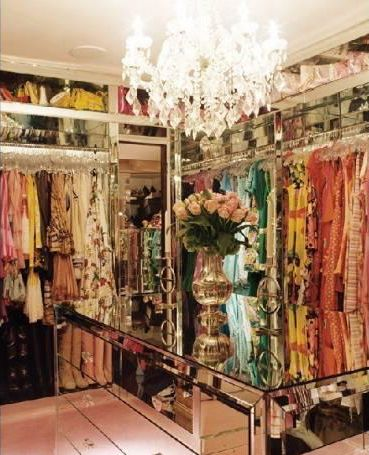Paris Hilton's glamorous walk-in closet/dressing area, which only holds a fraction of her wardrobe #celebrity #closet #dressing_room #mirrored