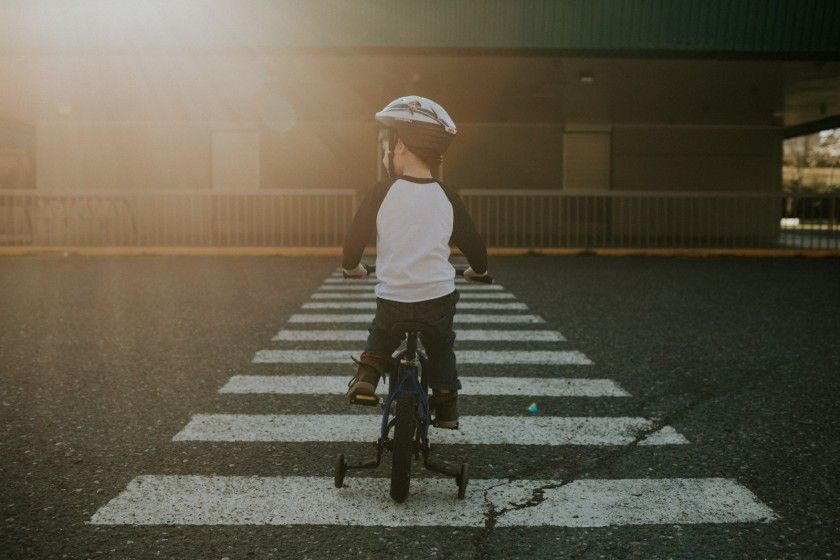 boy riding his bike with a helmet on by Cassandra McCasley of Twist and Shutter Photography