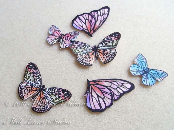 Once all the butterflies have been cut out, coat them with a layer of epoxy resin. Tutorial by Myléne Hillam of Mill Lane Studio.