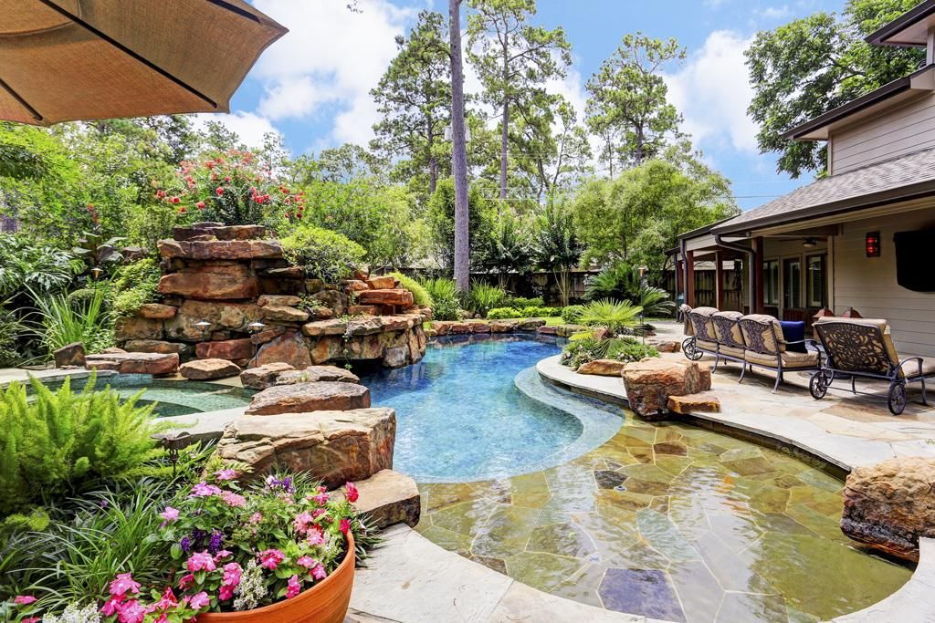 Alternate View Of The Backyard Shows Sparkling R Pool With Spa Surrounded By Flagstone Extensive Landscaping Sprinkler System And Large