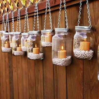 Mason jars with filler and candles. Looks great and simple.