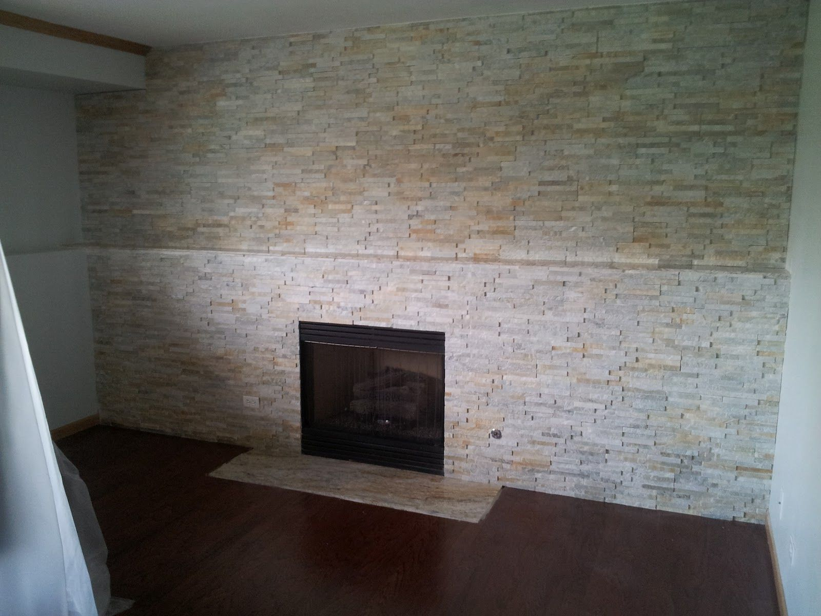 Stacked Stone Fireplace Surround j.fritz flooring: dry stack stone fireplace surround with granite