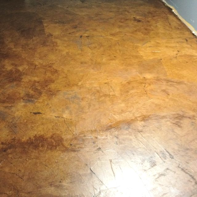 I got this paper bag floor idea from Pinterest, and decided to try it in our basement. Here's the final product after staining. Total investment = $75. Booyah!