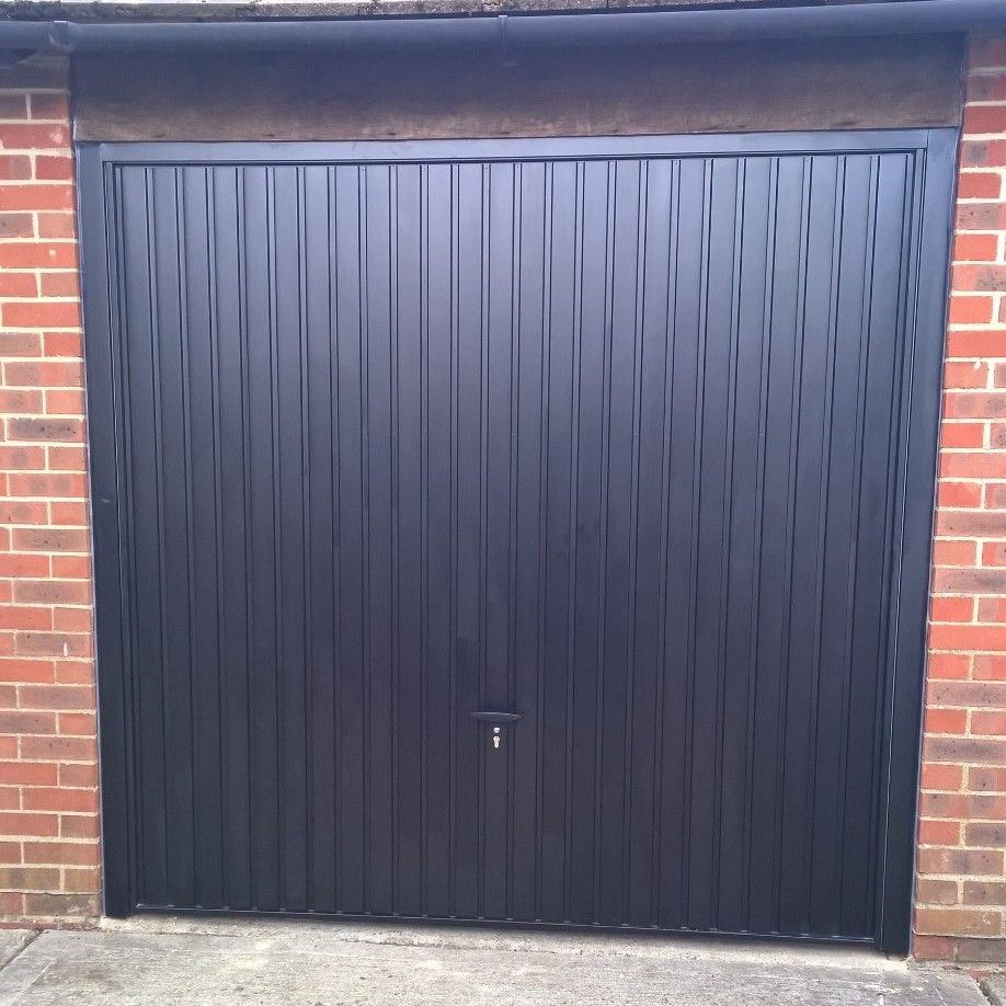 Retractable garage door - Black Thornby Retractable Garage Door Didcot This Pair Of Black Novoferm Thornby Up And Over Garage