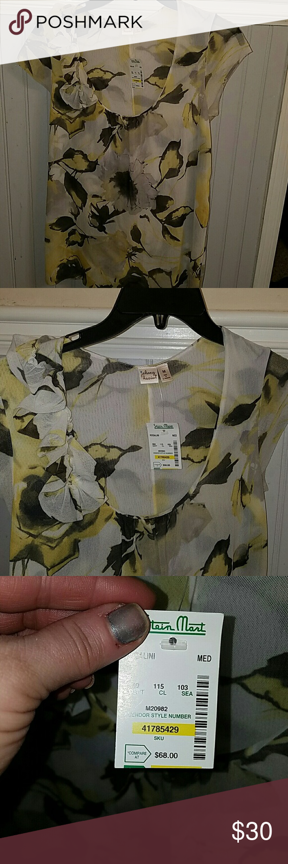 Beautful New blouse from Stein Mart. This is a beautiful blouse. Color is grey and yellow, ruffles on one side on the shoulder. Fully lined. Really pretty blouse. Johnny Reaven Tops Blouses