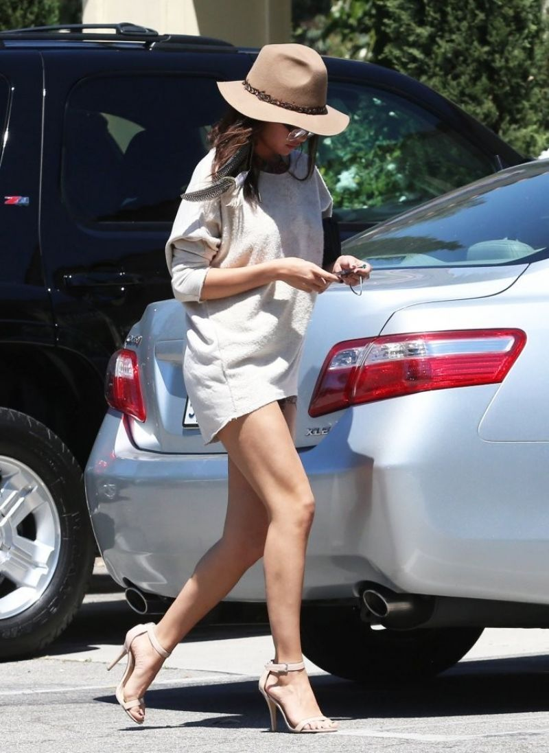 Selena Gomez.. Zimmermann Pink Writer Scarf Playsuit under a oversized sweater, with nude heels and fedora..