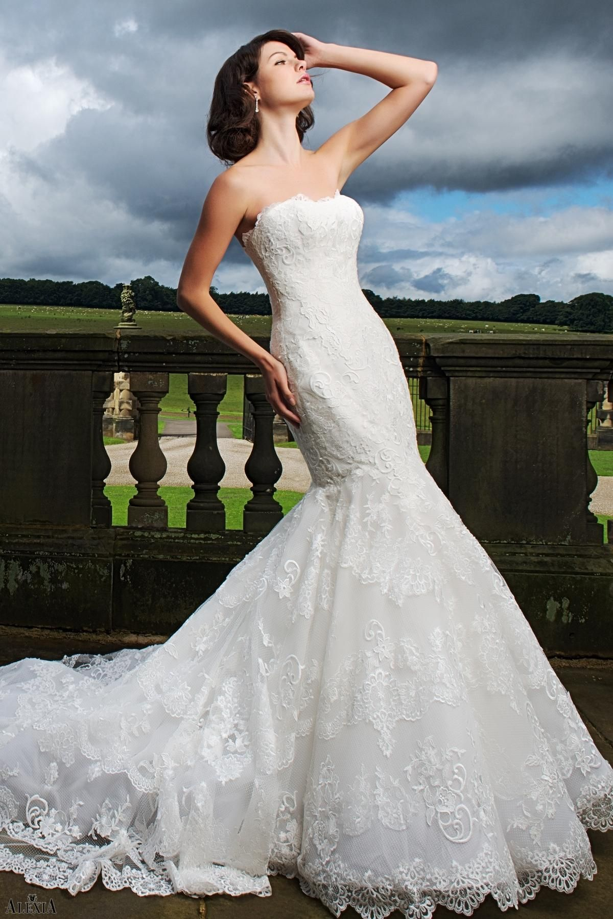 Wedding dress back  Dramatic Lace fishtail bridal gown Fitted with scallop neckline and