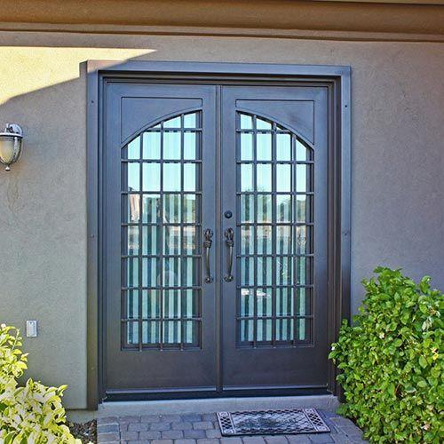 Puerta entrada herreria doble puertas puertas herreria for Puertas principales de casas