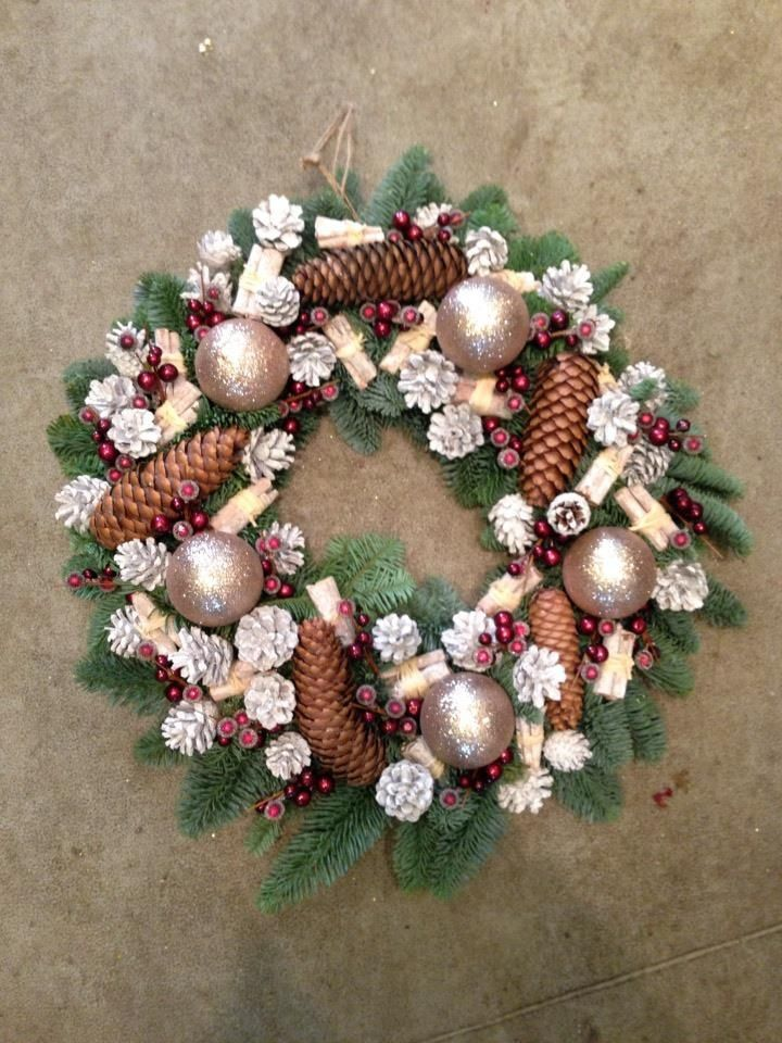 Christmas wreath with baubles, cones & berries