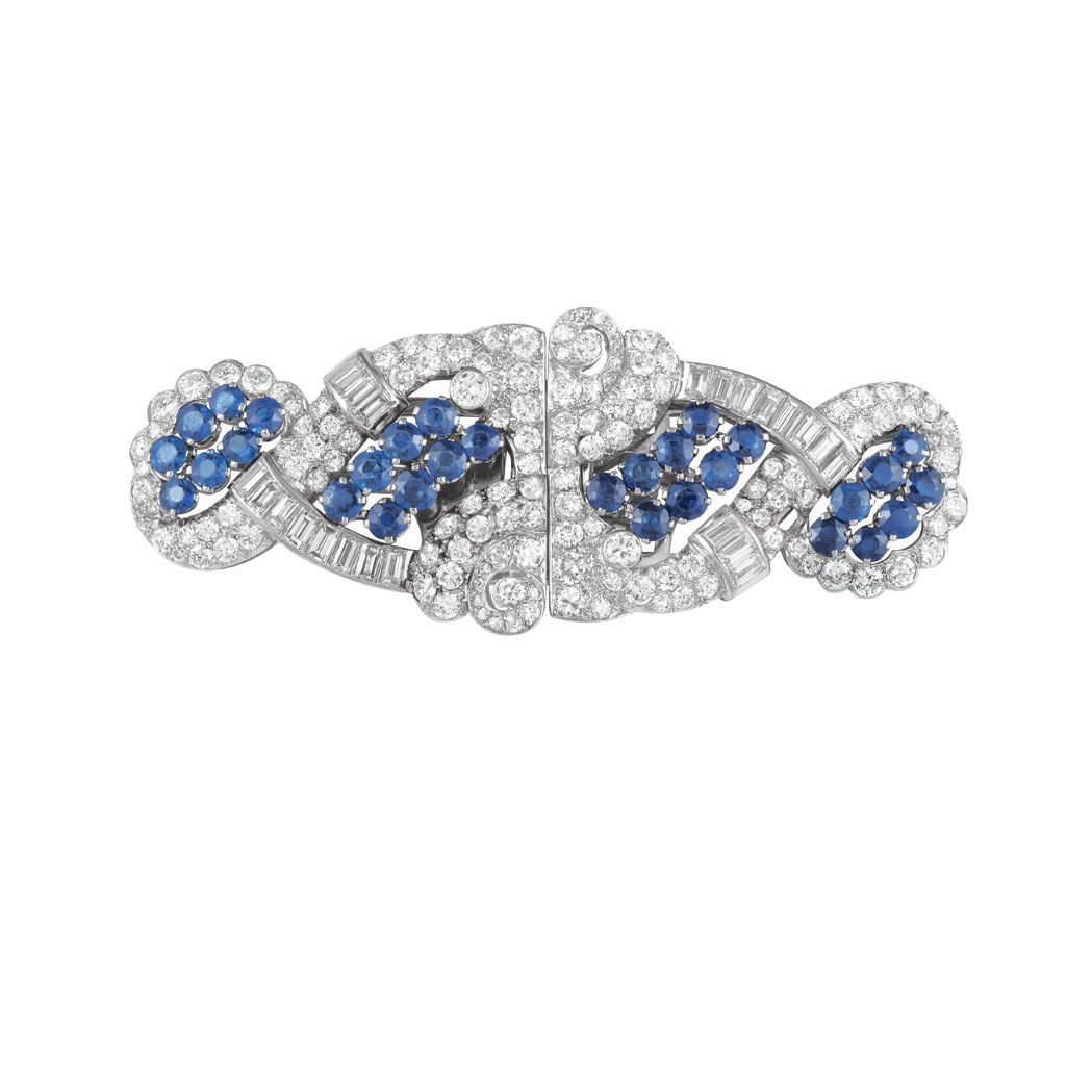 Platinum, Sapphire and Diamond Double Clip-Brooch The pierced double clip-brooch centering 30 round sapphires approximately 3.45 cts., set throughout with 134 round, old European and single-cut and 22 baguette diamonds, total approximately 6.20 cts., circa 1935, approximately 16.3 dwt.