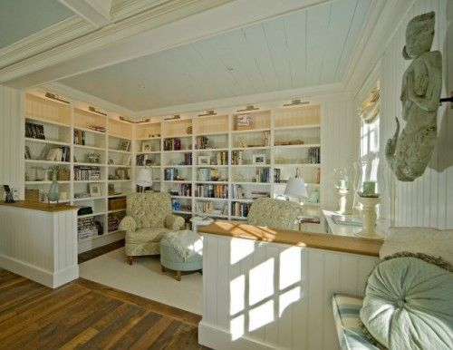 create reading nook or library in open space by doing similarly or lining up painted bookcases to create the sense of a separate room