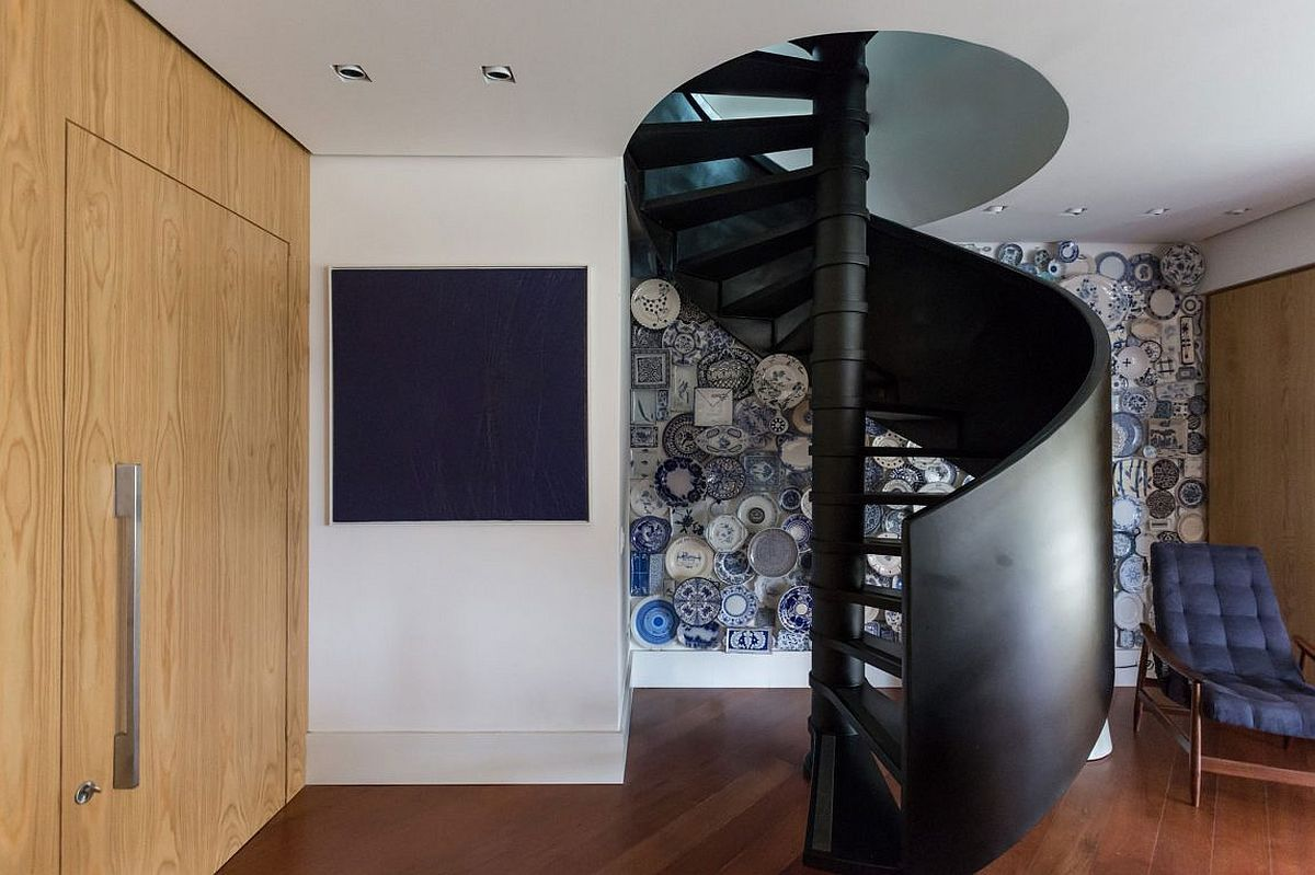 Spiral Staircase and Fun Accent Wall Steal the Show at Collector's Apartment