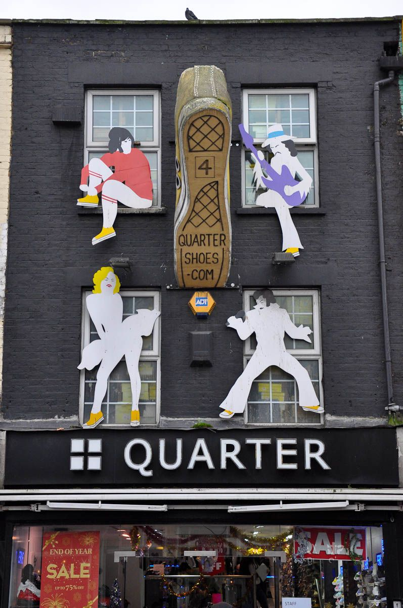 Shop fascia with a shoe and famous people, Camden Town, London, England