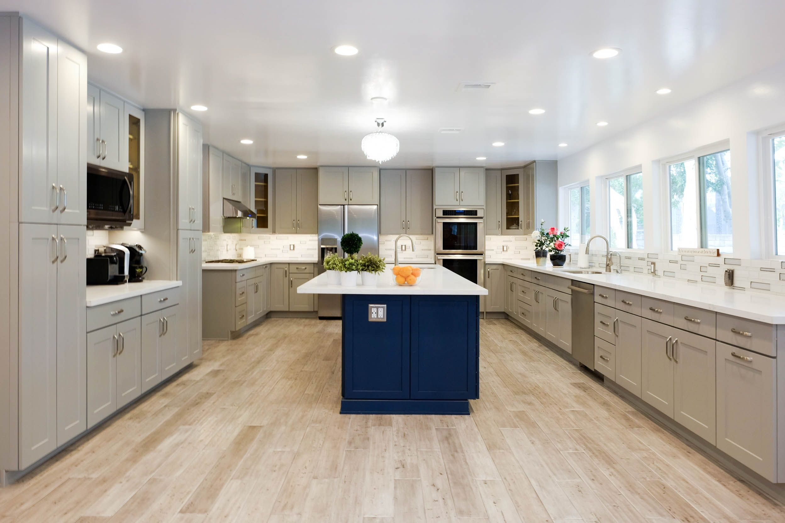 Large Expansive Kitchen With Grey Shaker Cabinets In Chatsworth Ca Custom Blue Island Wa Kitchen Cabinet Manufacturers Rta Kitchen Cabinets Kitchen And Bath