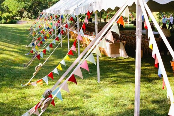 For a Funfair inspired venue why not have it outdoors with tents or marques and add lots of bunting