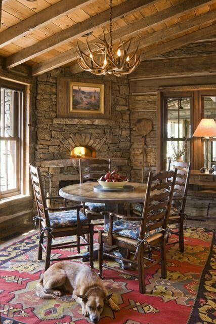 Corner Stone Fireplace And Round Table Smaller Timbers On Ceiling Another Example Of A Corner Fireplace Cabin Living Log Cabin Living Log Homes
