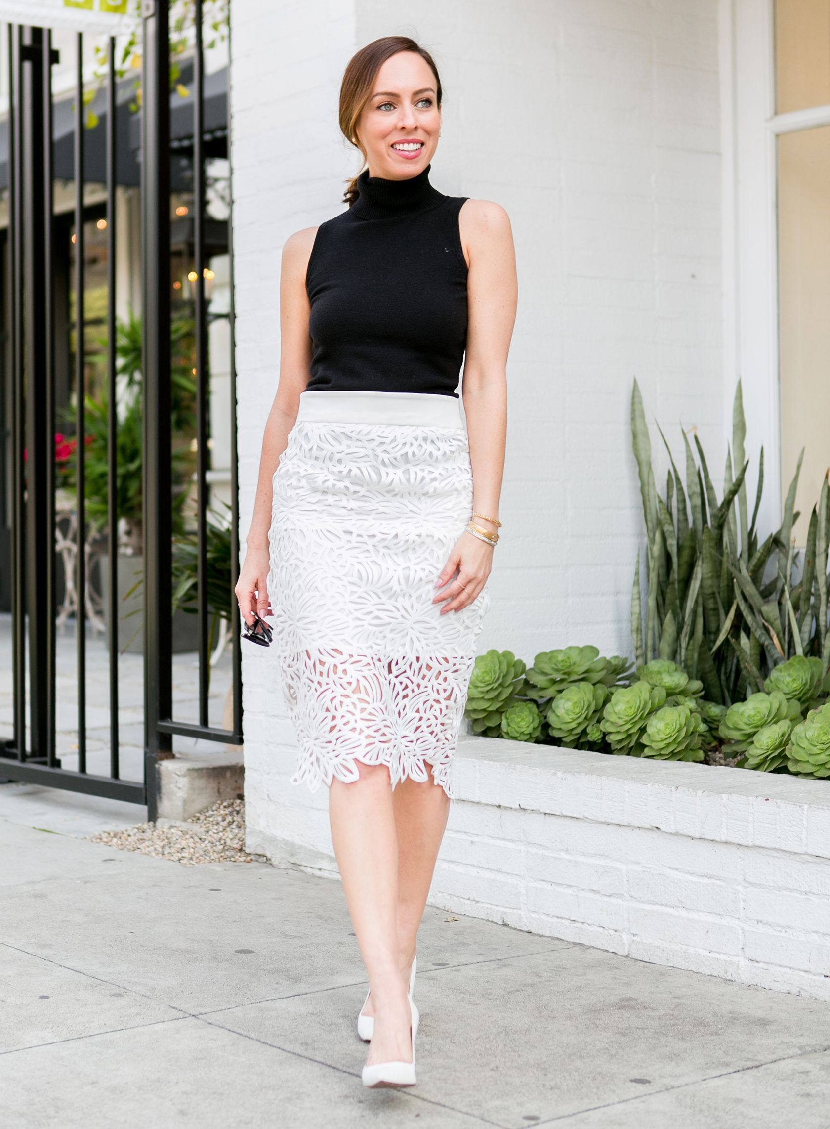e5f058b78e20 Sydne Style shows classic outfit ideas in a lace pencil skirt and  sleeveless turtleneck #lace #springoutfits #white #blackandwhite #turtleneck
