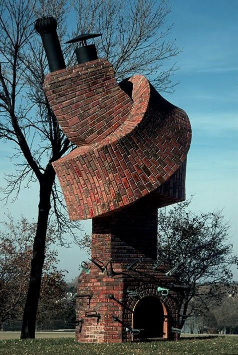 Performance piece by Dennis Oppenheim. A chimney is turned into a wind instrument, suggesting one could play, or perform it. The cavity of a functional object (chimney) is considered for it's sound producing qualities. Johnson County Community College, Oveland Park, Kansas (A chimney of whimsy).