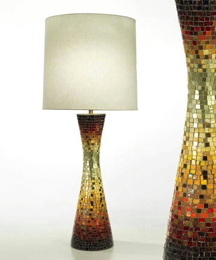 While Vladimir Kagan is perhaps better known for his sculpted, curvilinear chairs and lounges this lovely Murano glass tile mosaic over bronze lamp was produced by Kagan-Dreyfuss, New York in the 1950's.