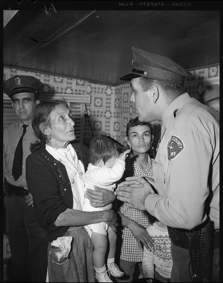 Title:	Sheriff Deputies evict Abrana Arechiga from Chavez Ravine home Publication:	Los Angeles Times Publication date:	May 9, 1959