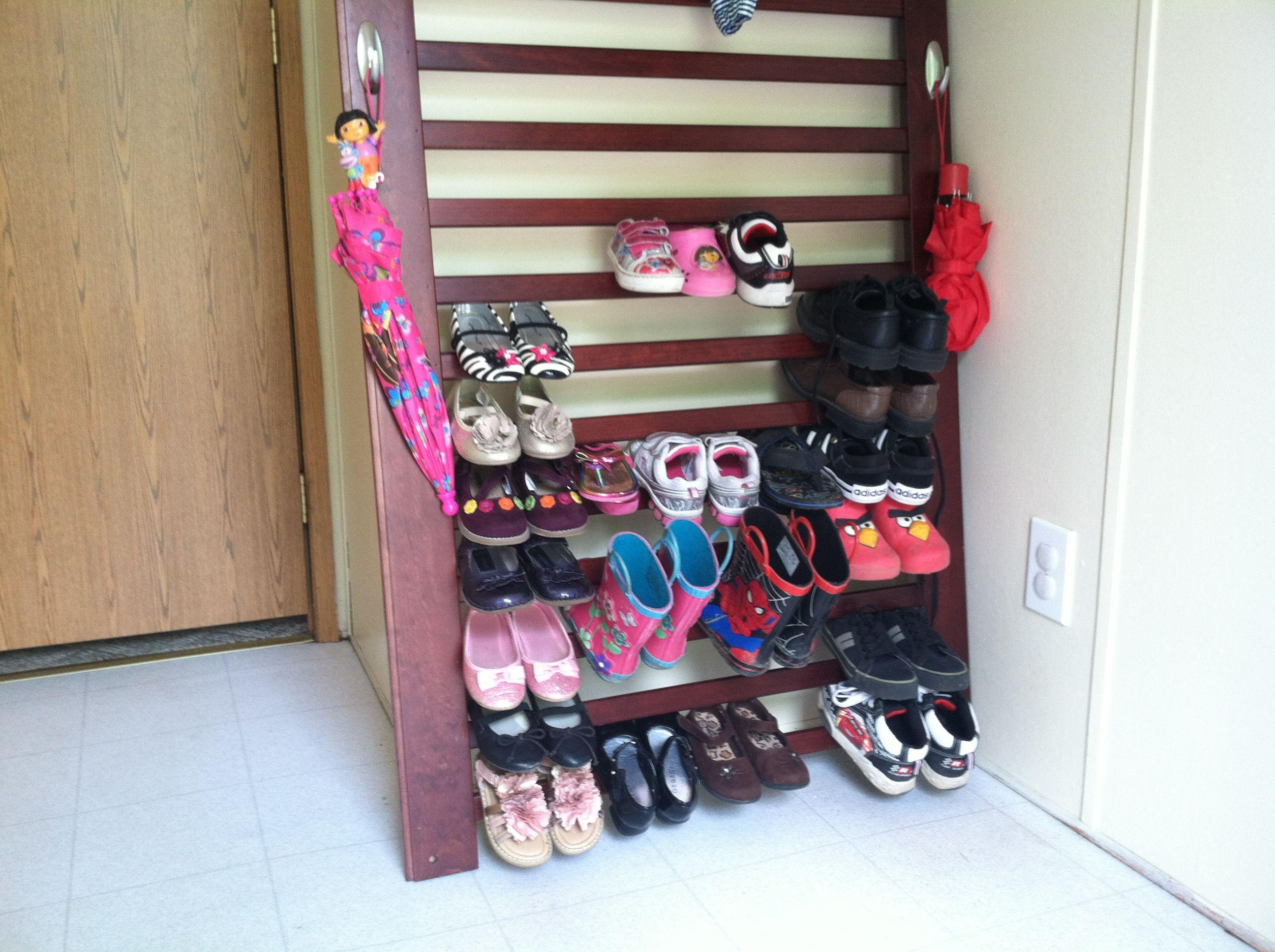 old crib part turned shoe rack