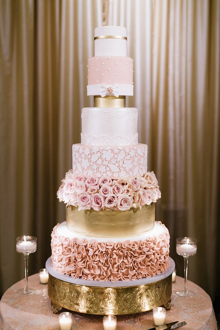 Wedding decorations luxury  This blush and gold luxury wedding cake is sure to wow your guests