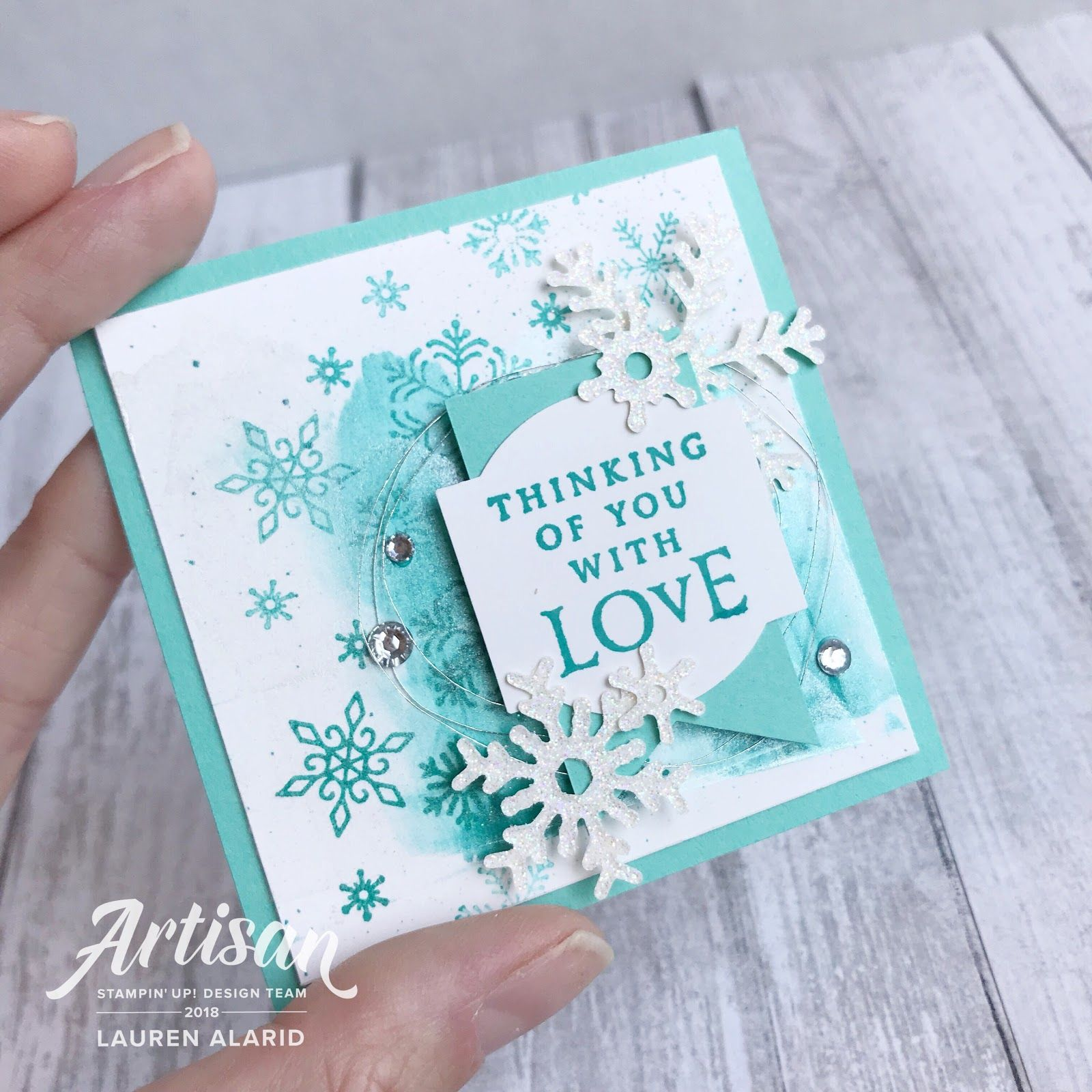 Stampin' Up! Beautiful Blizzard  Shimmer Paint Snowflake Christmas Card is part of Christmas snowflakes card, Snow christmas cards, Christmas note cards, Christmas cards, Stampin up christmas cards, Printable christmas cards - Hey peaches! I hope that you're having a great week so far  I am on the blog today sharing a fun and easy technique using the brand new Beautiful Blizzard Stamp Bundle and Shimmer Paints  This set is absolutely gorgeous! I love that the coordinating die set cuts out these delicate little snowflakes, but that's not all! Because the die is one whole piece, you can use the negative piece as well! I just love that  For today's technique, we will be making a shimmer spread background  I thought this set would be perfect to combine with this technique because it's designed to create breathtaking flurries of snow  Here's how you create the background 1  Take your Frost White Shimmer Paint and add four drops, spaced evenly, along one side of your Watercolor Paper  The reason I chose watercolor paper is because this paper will not absorb the paint instantly, allowing you to spread the paint smoothly  2  Add a drop of Bermuda Bay Ink Refill to every other drop or shimmer paint  3  Take an old gift card and spread the paint, in a smooth swipe, across the paper  You can go back and run over it again to spread it more evenly if you like  The results are really quite unique and stunning! Here's a closeup of the finished card  Thanks so much for stopping by and I'll see you next post! I wanted to include the little lunchbox note that I made using a little paint that was left over on my gift card after swiping  I just couldn't bear to waste it  Don't forget! You can find me on Instagram and Facebook! Happy stamping! Bonus Days are back!!! For every $50 you spent during the month of August, you will have earned a $5 bonus coupon  Redeem your coupon codes September 130  Use my host code (XMUDHWJ9) for even more bonus items  Contact me for more info Craftylittlepeach@gmail com Host A Party Get your friends together and host a party to earn Stampin' rewards during the month of August! Contact me to book an event! To order online September 2018 Hostess Code XMUDHWJ9 Or email me @ Craftylittlepeach@gmail com Join My Team! If you've considered joining, it's a truly great time! For just $99, you can select $125 of your choice of product AND earn a 20% discount on purchases from the Annual Catalog  This is an amazing deal! If you want to join my team, click here or please email me! Supplies Beautiful Blizzard ClearMount Bundle $45 75 Frost White Shimmer Paint $8 00 Bermuda Bay Classic Stampin' Ink Refill $3 75 Bermuda Bay Classic Stampin' Pad $7 50 Watercolor Paper $5 00 Blueberry Bushel Classic Stampin' Pad $7 50 Sparkle Glimmer Paper $5 00 Metallics Sequin Assortment $5 00