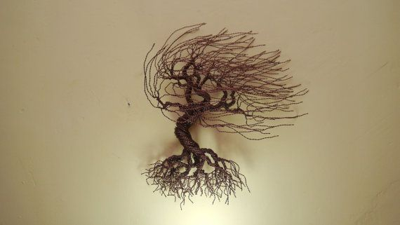 WIND SWEPT WIRE TREE FOR WALLS  This wire tree looks exactly like a tree in the wind. It can make you feel very dynamic and powerful, because of the motion it tries to express. This wire tree is approx. 30 cm (11,8 inch) high and has more than 100 branches.  THE VALUE OF A WIRE TREE  Our wire trees are sparkling and appear unique thanks to the lacquered copper wire material we use while creating them. The copper itself is also a precious material, however the worth of our trees are not…