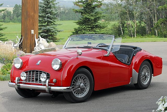 1957 Triumph TR3 - daddy has his stored away. I'd love to see it restored