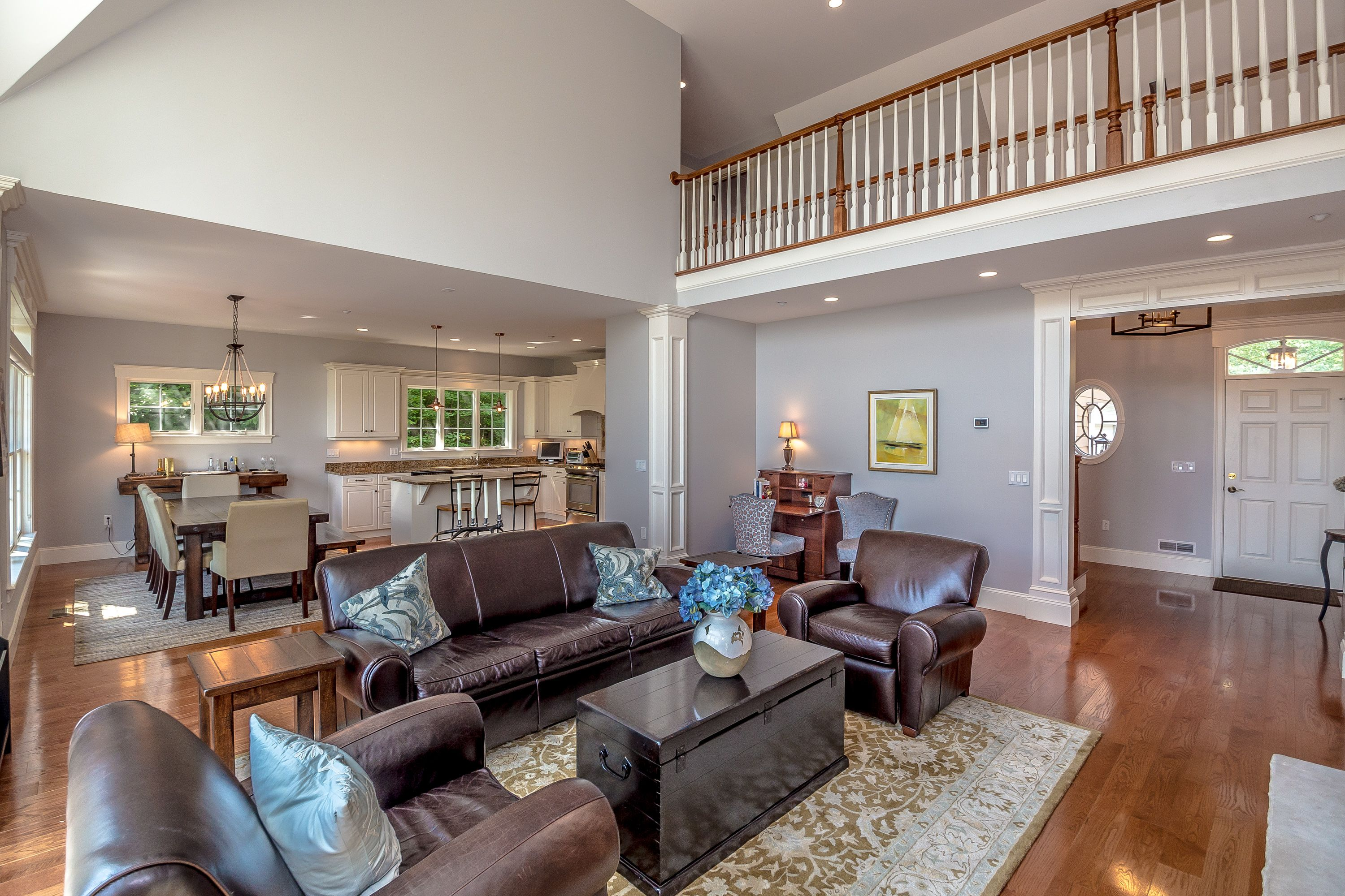 Open concept living boasts lake and mountain views from ...