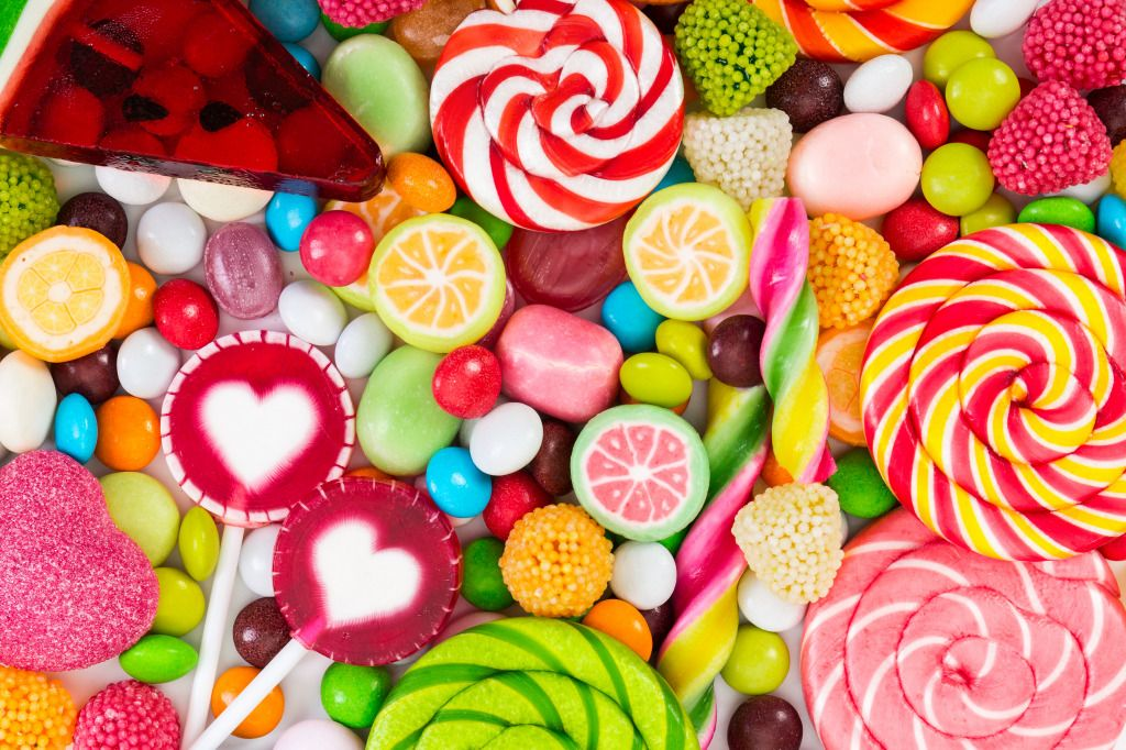 Colorful candy jigsaw puzzle in macro puzzles on