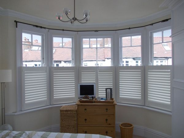 Four bend 19mm Cameron Fuller bay window curtain pole with cafe shutters