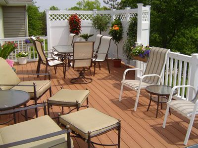 Add a section of privacy vinyl fencing into your deck railing to hang flowers and to add privacy to your deck!