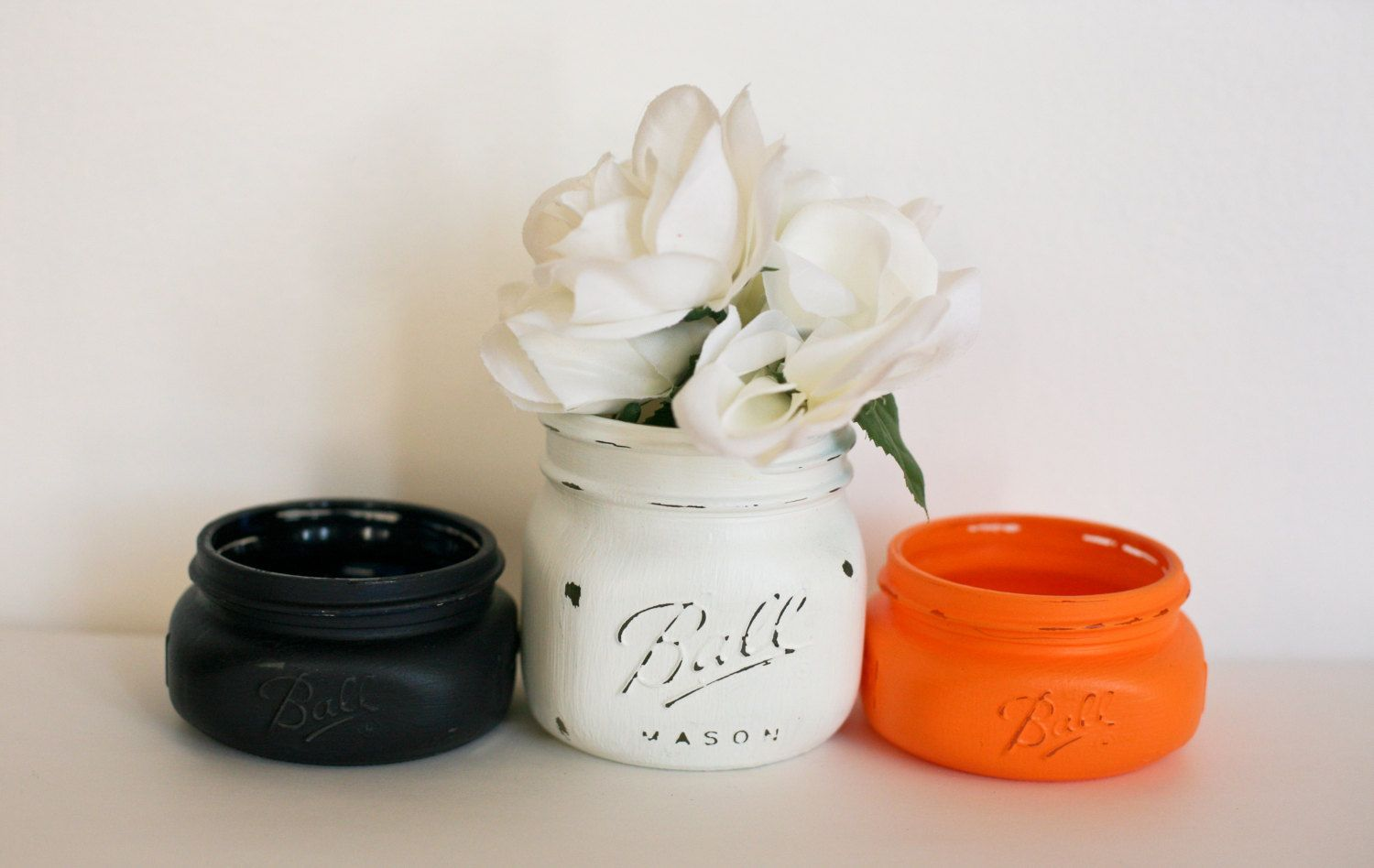 Cream, navy blue and tangerine painted mason jars. http://www ...