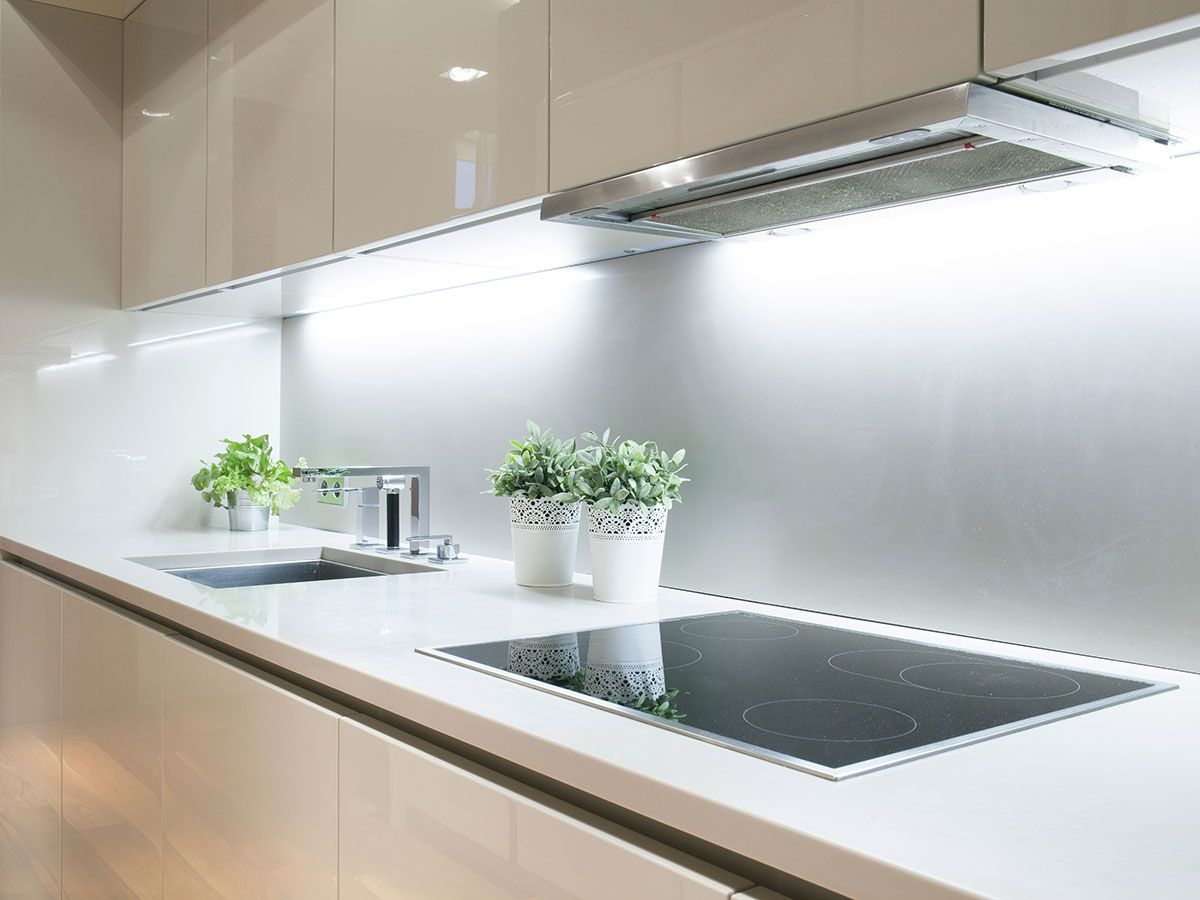 Monaco Street kitchen: All-white with integrated sink, white glass ...