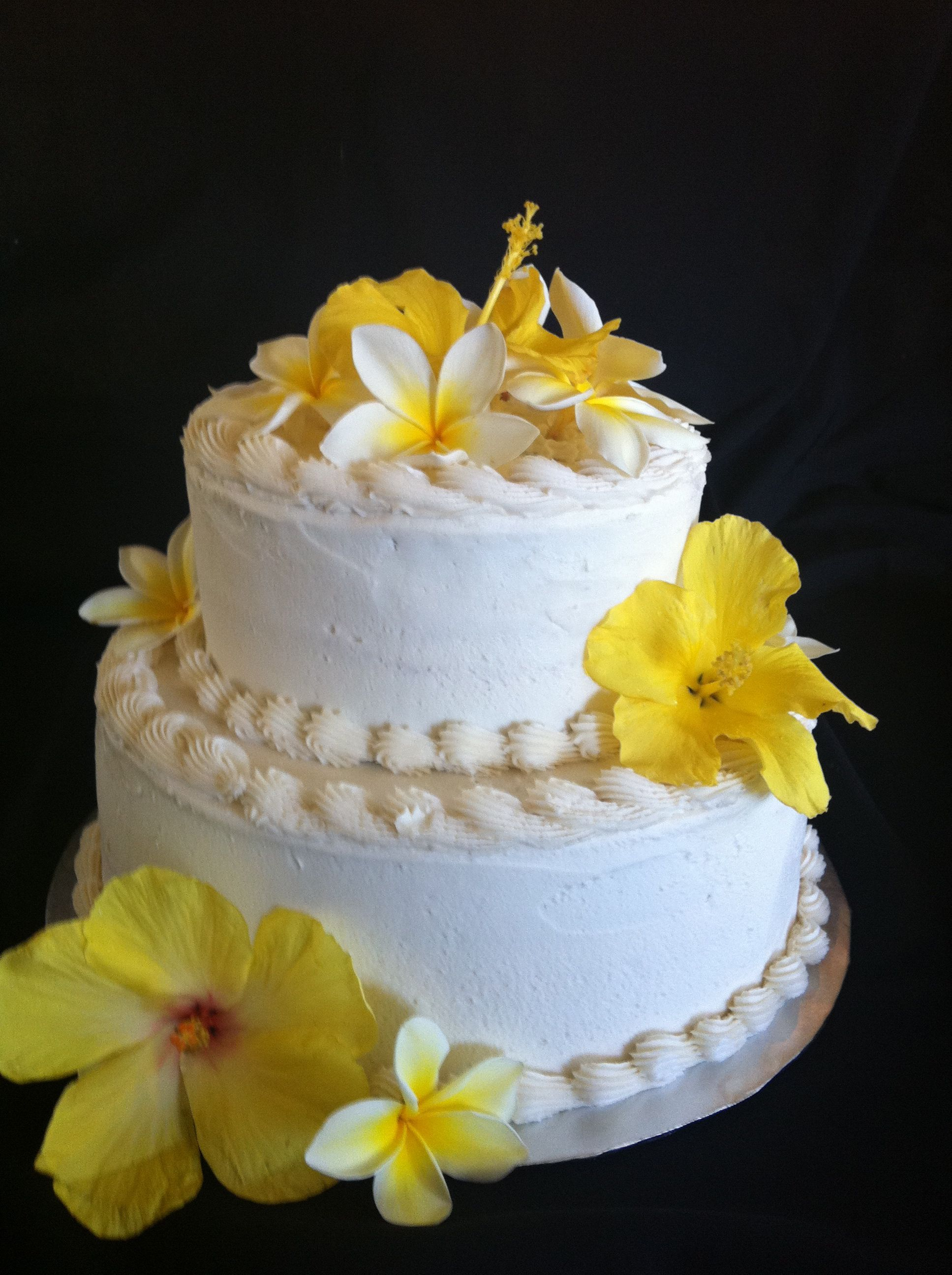 Wedding Cake With Yellow Hibiscus And White Plumeria Flowers