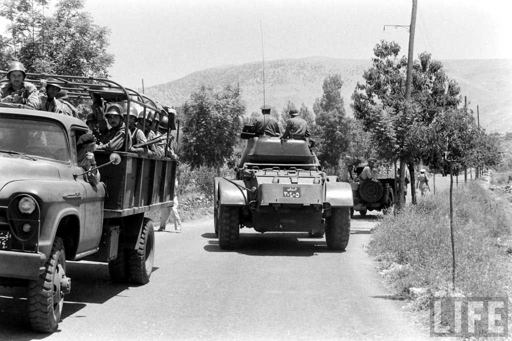 A Lebanese Darak/Gendarmerie Staghound Mark I w/QF 2pdr gun passing next to a Lebanese Army Chevrolet Apache 1956 model cargo truck.