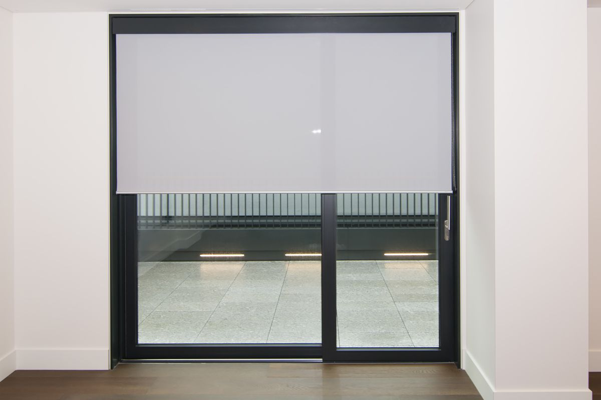 Sunscreen Roller Blind Fitted To Floor To Ceiling Windowsliding