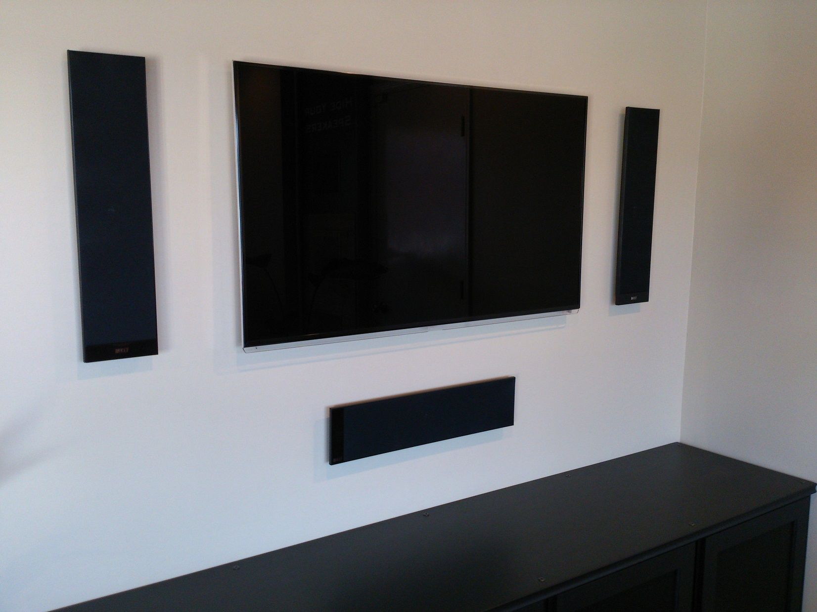 living room sound system. Great sound without bulky speakers is possible with the T305 KEF 5 1  surround system