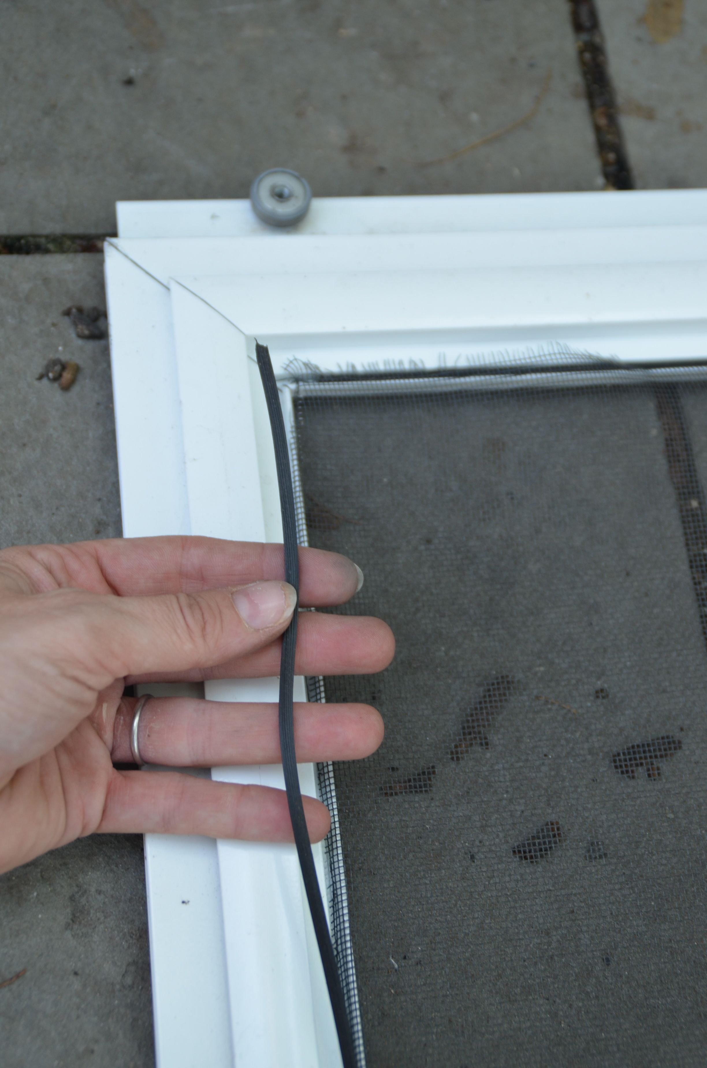How To Replace The Screen In A Screen Door Or Window Screen Door
