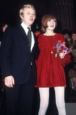 Cilla Black and Bobby Willis on their wedding day in 1968. Cilla is wearing a red velvet mini dress designed by John Bates.
