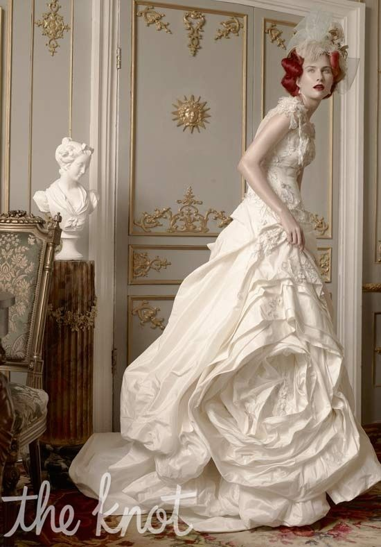 St. Pucchi wedding gown. Gown features sheer jewel neckline, beading ...